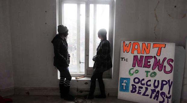 Protesters Jessica Fox (left) and Cathy pictured in the old Bank of Ireland building on Royal Avenue in Belfast