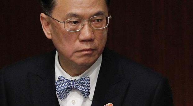 Donald Tsang has apologised as investigators probe claims he took favours from tycoons (AP)