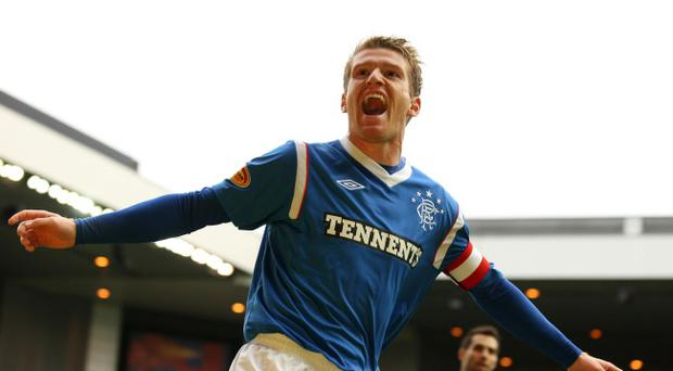 Rangers players including Northern Ireland's Steven Davis are waiting to hear if they have a future at the club.