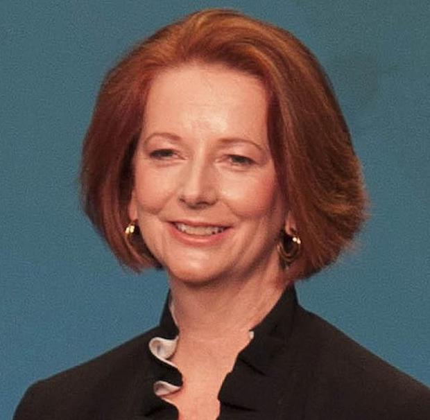 Julia Gillard has axed one of her rival's supporters in a Cabinet reshuffle