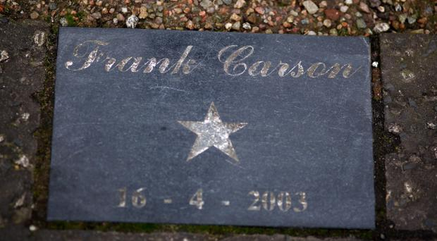 A name plate pictured on Donegall Street where Frank Carson planted a tree in 2003.