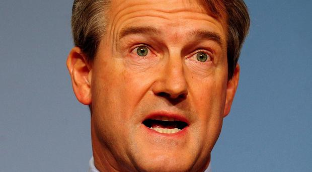 Owen Paterson was expected to attend a Westminster debate on Thursday night, but instead attended to constituency business.