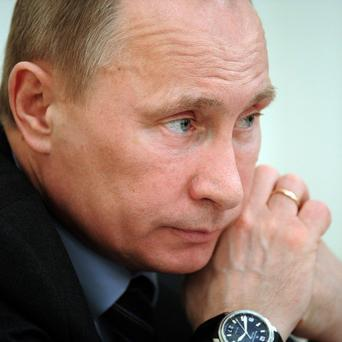 Russian PM Vladimir Putin refused to speculate on Assad's chance to hold on to power in Syria
