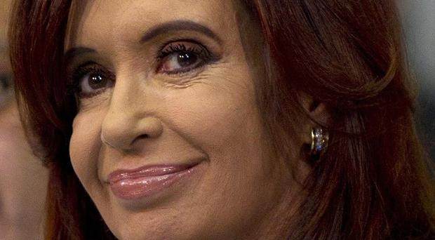 Argentina's President Cristina Fernandez said flights by a state-owned airline to the Falklands would show the country's aims were peaceful (AP)