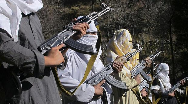 Masked Pakistani Taliban militants take part in a training session near the Afghan border(AP)