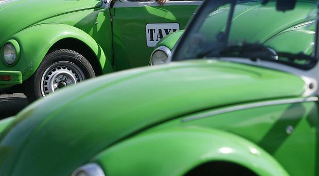 Mexico City has announced that the last of the iconic Volkswagen Beetle taxis will be withdrawn from service (AP)