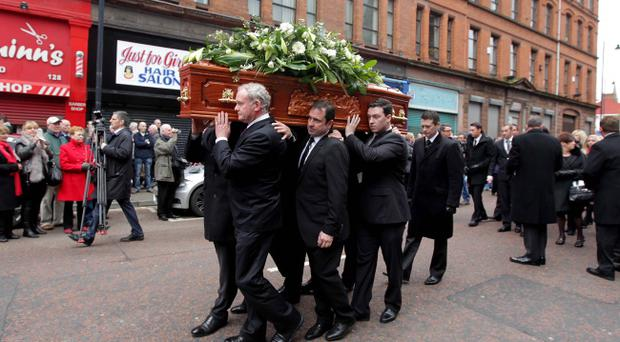 Frank Carson's coffin is carried down Donegall Street, Belfast