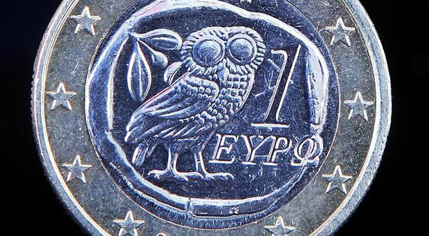 Moody's has lowered Greece's sovereign rating to the lowest point on its scale (AP)