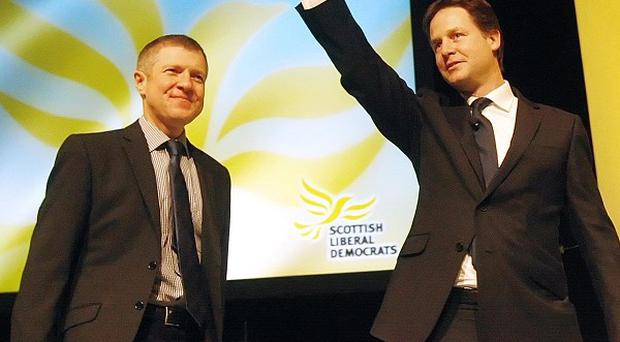 Deputy Prime Minister Nick Clegg with Scottish Lib Dem leader Willie Rennie following his address to the spring conference