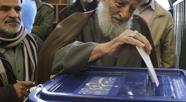 Votes are cast in elections in Iran (AP)