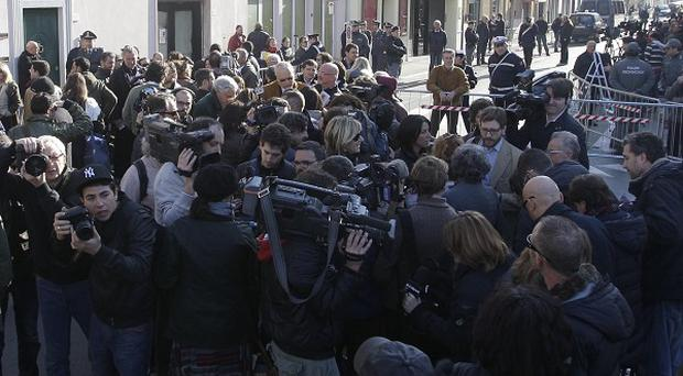 Crowds gather outside the Moderno theatre in Grosseto, Italy, ahead of the Costa Concordia shipwreck evidence hearing (AP)