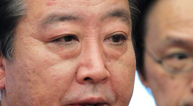 Japanese prime minister Yoshihiko Noda admitted failings in the government's response to last year's tsunami disaster (AP)