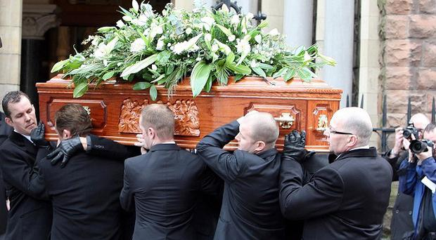 The coffin of comedian Frank Carson is carried into his funeral Mass at St Patrick's Church in Belfast