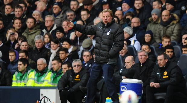 LONDON, ENGLAND - MARCH 04: Tottenham Hotspur manager Harry Redknapp directs his team during the Barclays Premier League match between Tottenham Hotspur and Manchester United at White Hart Lane on March 4, 2012 in London, England. (Photo by Mike Hewitt/Getty Images)