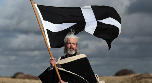 Local actor Colin Retallick plays the role of St Piran during the annual processional play to celebrate St Piran, patron saint of tinners and regarded by many as Cornwall's premier saint, on March 4, 2012 in Perranporth, England.