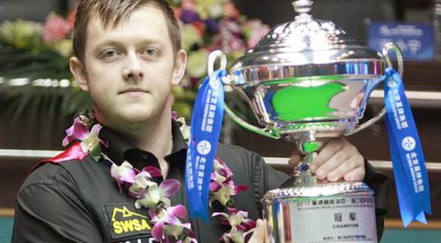 Flower power: Mark Allen after his World Open triumph in China, the Ulsterman hammering Stephen Lee 10-1 in yesterday's final