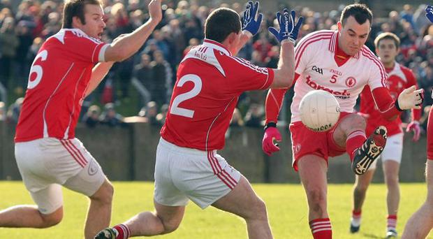 Attack minded: Louth's Michael Fanning, Gerard Hoey and Dessie Finnegan try to block the shot of Cathal McCarron yesterday
