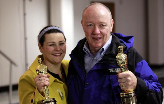 Oscar-winning Belfast director Terry George and his daughter Oorah arrive at Belfast International Airport, Monday, March, 5 2012.