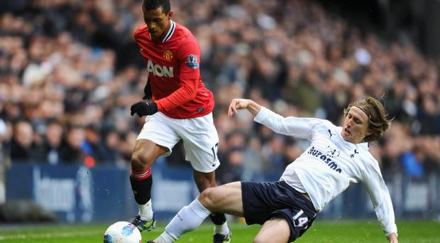 Nani (left), seen here in action against Spurs on Sunday, is set to become one of Manchester United's top earners