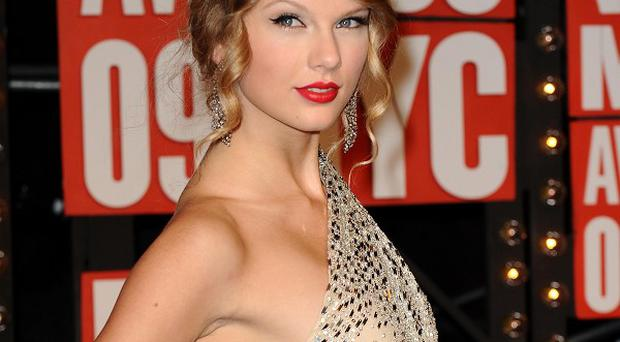Taylor Swift voices a character in The Lorax, which is No 1 in America