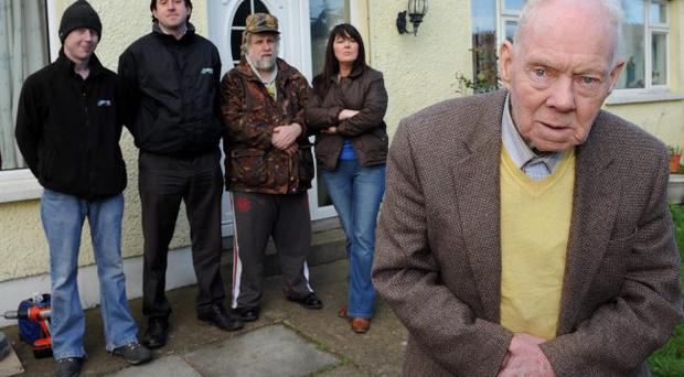 Jimmy Murtagh outside his home yesterday as John Hughes and Niall King (left and second left), from JMC Mobile Ltd, installed CCTV and security lighting free of charge. Showing their support for the two brothers yesterday were neighbour Michael Collins and neice Angela Murtagh