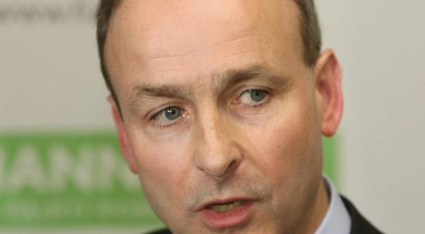 Fianna Fail leader Micheal Martin has apologised for his party's role in leading Ireland from boom to bust