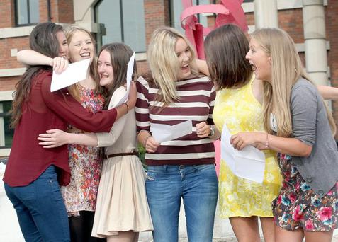 Pupils at Thornhill College in Londonderry celebrate their marks in the A-level examinations. Data shows that 11 out of 68 grammar schools failed to hit the average mark