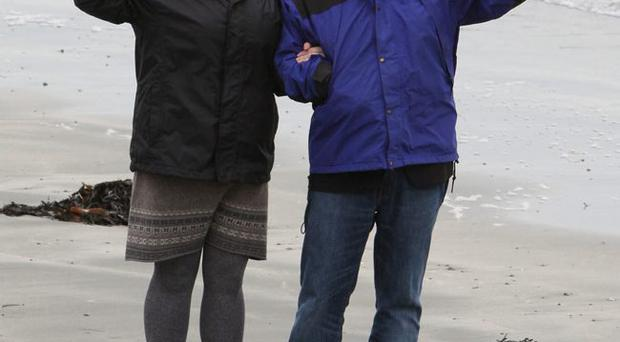 Shore thing: Terry George and daughter Oorlagh on beach at Coney Island yesterday