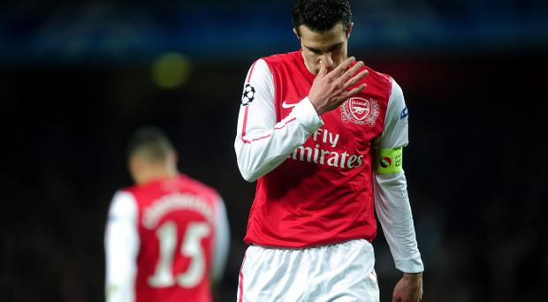 LONDON, ENGLAND - MARCH 06: Robin van Persie of Arsenal looks dejected during the UEFA Champions League Round of 16 second leg match between Arsenal and AC Milan at Emirates Stadium on March 6, 2012 in London, England. (Photo by Laurence Griffiths/Getty Images)