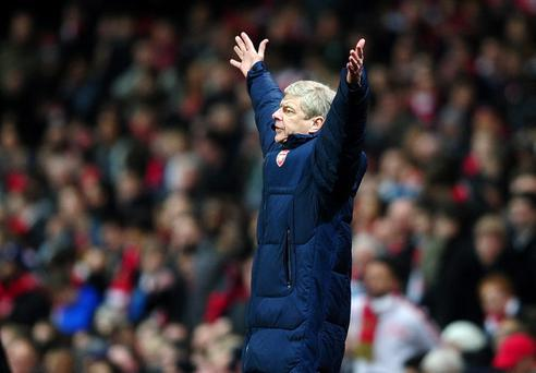 LONDON, ENGLAND - MARCH 06: Manager of Arsenal, Arsene Wenger shouts instructions during the UEFA Champions League Round of 16 second leg match between Arsenal and AC Milan at Emirates Stadium on March 6, 2012 in London, England. (Photo by Laurence Griffiths/Getty Images)