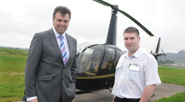 Aero-Heli is being assisted by Invest NI to expand business; during a visit to Aero-Heli is (left), Alastair Hamilton, Invest NI Chief Executive, with pilot Jonathan Beckett
