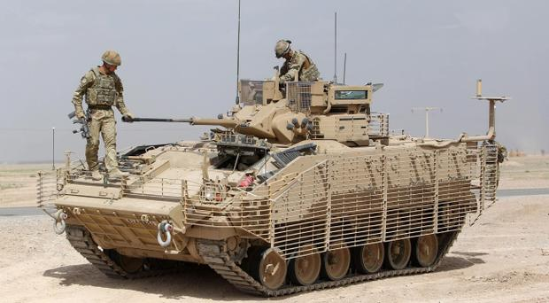 File photo dated 14/04/11 of a warrior vehicle similar to the one that was caught in an explosion in Afghanistan today
