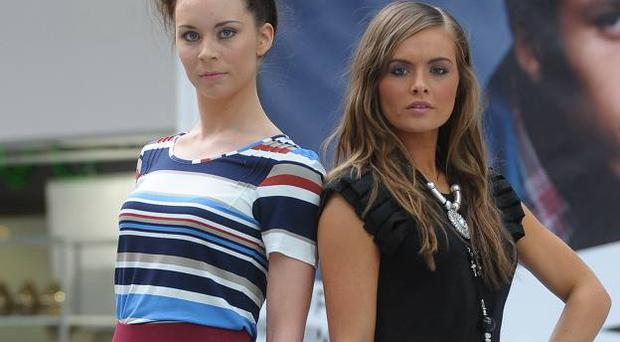 Aran Patterson and Tiffany O'Brien model clothes by Marks and Spencer, left and Wallis on the podium