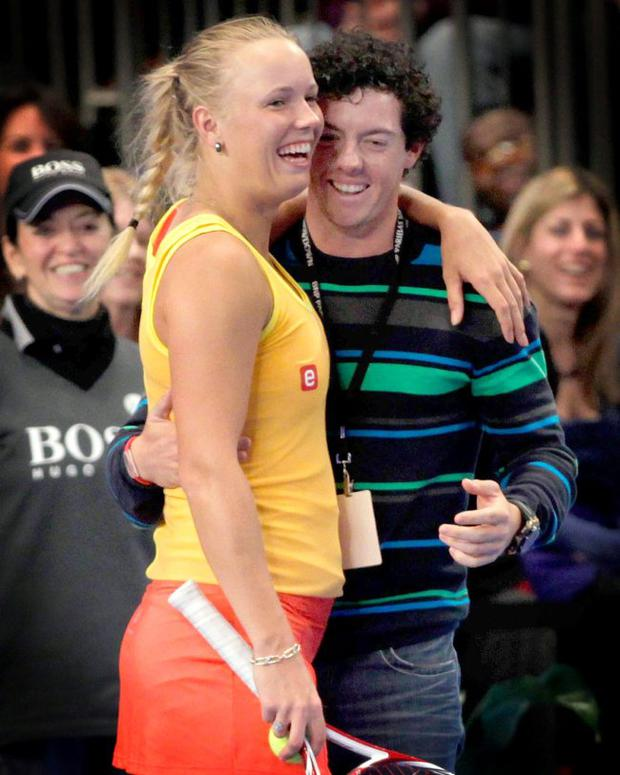 Rory McIlroy joins his girlfriend Caroline Wozniacki on the court during the BNP Paribas Showdown at Madison Square Garden in New York yesterday