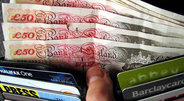 A report urged the Government to limit the rolling over of payday loans