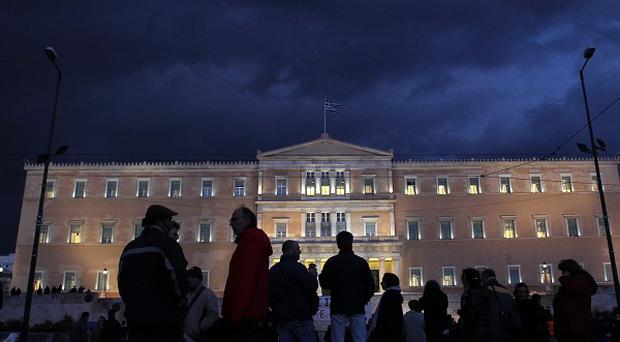 Protesters at a rally held by Greece's largest unions outside the Greek parliament in central Athens (AP)