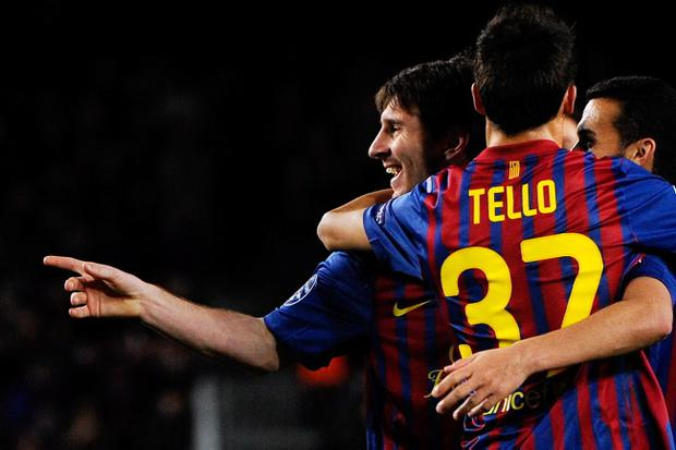 BARCELONA, SPAIN - MARCH 07: Lionel Messi of FC Barcelona (L) celebrates with his teammate Christian Tello of FC Barcelona after scoring his fifth goal, seventh of FC Barcelona during the UEFA Champions League round of 16 second leg match between FC Barcelona and Bayern 04 Leverkusen at Camp Nou on March 7, 2012 in Barcelona, Spain. FC Barcelona won 7-1 and Lionel Messi scored 5 goals. (Photo by David Ramos/Getty Images)
