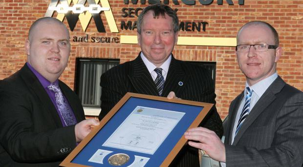 Liam Cullen (left) and Francis William Cullen (right) of Mercury Security Management Ltd, Northern Ireland's biggest independent security management company, receive the National Security Inspectorate's prestigious NSI ARC Gold Medal from NSI Chief Executive Jeff Little.