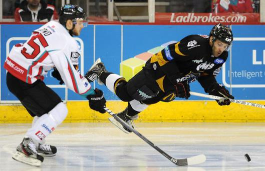 Lift off: Robert Dowd of Belfast Giants gets in a tackle on Nottingham Panthers' David Clarke in wednesday night's Challenge Cup Final first leg at the Odyssey