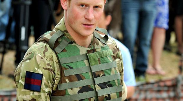 Prince Harry joined in a live-firing exercise at the Up Park Army Camp, in Kingston, Jamaica