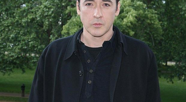 John Cusack immersed himself in Edgar Allan Poe's life for The Raven