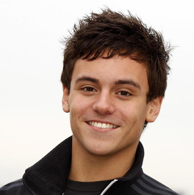 Diver Tom Daley has revealed his A-level results on Twitter