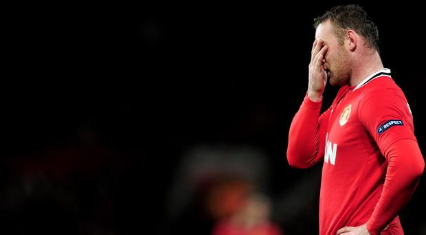 MANCHESTER, ENGLAND - MARCH 08: Wayne Rooney of Manchester United looks dejected during the UEFA Europa League Round of 16 first leg match between Manchester United and Athletic Bilbao at Old Trafford on March 8, 2012 in Manchester, England. (Photo by Jamie McDonald/Getty Images)