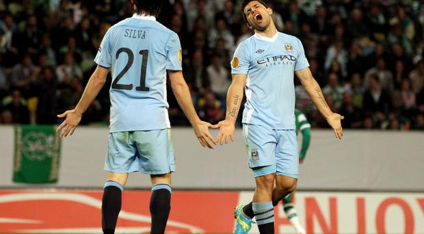 LISBON, PORTUGAL - MARCH 08: Sergio Aguero (R) and David Silva of Manchester City look dejected during the UEFA Europa League Round of 16 between Manchester City and Sporting Lisbon at Estadio Jose Alvalade on March 8, 2012 in Lisbon, Portugal. (Photo by Scott Heavey/Getty Images)