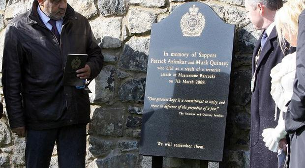 Family members of murdered sappers Mark Quinsey and Patrick Azimkar attend the unveiling of a memorial stone to the two soldiers
