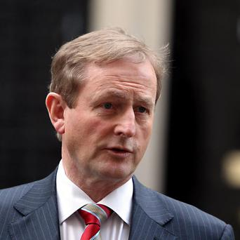 Taoiseach Enda Kenny has had to cancel a photocall to mark the Government's first year in power