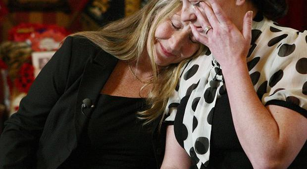 Elaine Freeman, left, mother of Sgt Nigel Coupe, hugs her daughter-in-law Natalie Coupe at Fulwood Barracks in Preston
