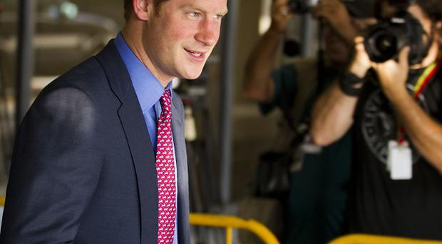 Prince Harry leaves the airport in Rio de Janeiro, Brazil (AP)