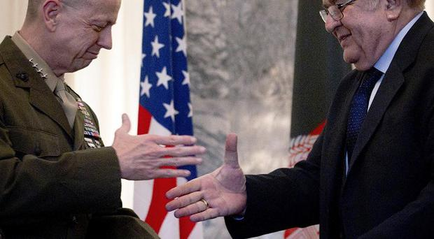 US General John Allen, left, and Afghan defence minister General Abdul Rahim Wardak made a deal over detainees (AP)