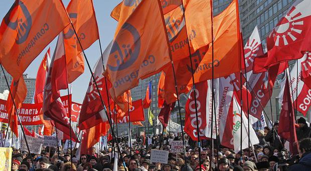 Opposition protesters with their flags gathered in centre of Moscow during a rally (AP)